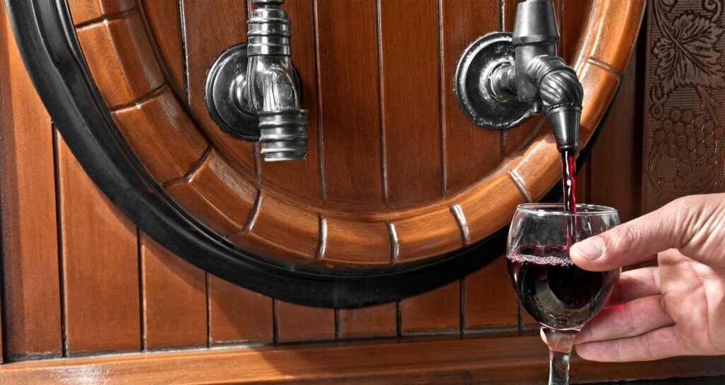 wine cask with a glass of red wine